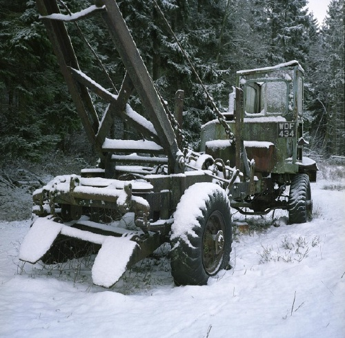 The same forestry truck, only now in snow.